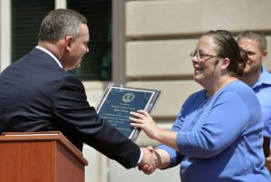 A Baptist minister encourages anti-gay bigotry by awarding Kim Davis a plaque.